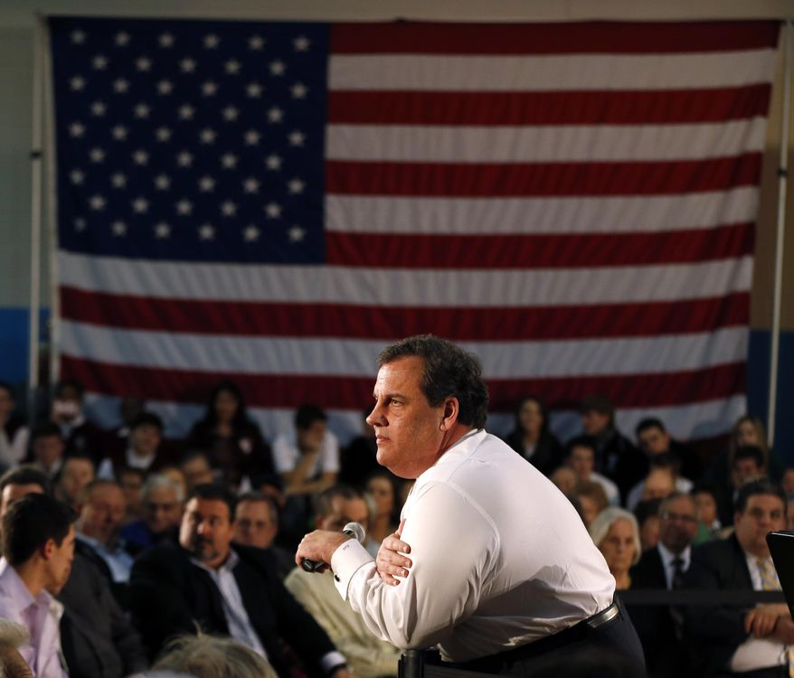 New Jersey Gov. Chris Christie listens to a question from an audience member during a town hall meeting at Winston Churchill Elementary School, Wednesday, April 9, 2014, in Fairfield, N.J. (AP Photo/Julio Cortez)