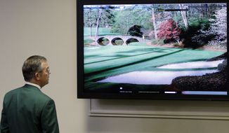 Chairman of Augusta National Golf Club Billy Payne looks at television monitor before his news conference at the Masters golf tournament in Augusta, Ga., Wednesday, April 7, 2010. The tournament begins Thursday, April, 8. (AP Photo/Rob Carr)