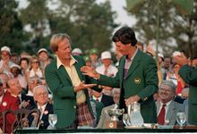 Larry Mize, right, 1987 Masters winner, and Jack Nicklaus, last year's winner, prepare to shake hands during ceremonies at the Augusta National Golf Club, April 12, 1987.  (AP Photo)