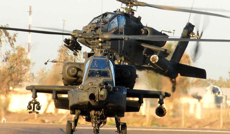 The DOJ has accused four men of stealing $100 million worth of information from Microsoft Corporation and simulator software used to train Apache attack helicopter pilots. (U.S. Army photo by CW4 Daniel McClinton, 1-227th, 1st ACB, 1st Cav. Div. Public Affairs)