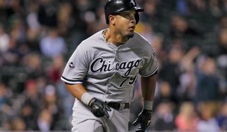 Chicago White Sox Jose Abreu hits a home run during the eighth inning of a baseball game against the Colorado Rockies, Tuesday, April 8, 2014, in Denver. (AP Photo/Barry Gutierrez)