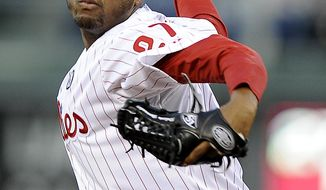 Philadelphia Phillies starting pitcher Roberto Hernandez delivers in the first inning of a baseball game against the Milwaukee Brewers, Wednesday, April 9, 2014, in Philadelphia. (AP Photo/Michael Perez)