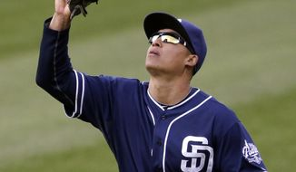San Diego Padres center fielder Will Venable catches a fly ball hit by Cleveland Indians' Yan Gomes in the ninth inning of the second game of a baseball doubleheader on Wednesday, April 9, 2014, in Cleveland. The Padres defeated the Indians 2-1. (AP Photo/Tony Dejak)