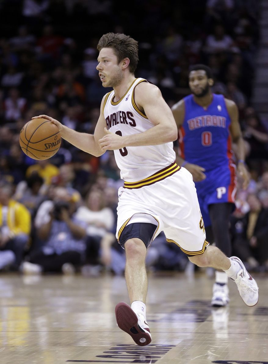 Cleveland Cavaliers' Matthew Dellavedova runs the ball up in the second quarter of an NBA basketball game against the Detroit Pistons Wednesday, April 9, 2014, in Cleveland. Dellavedova scored 14 points and had 12 assists in the 122-100 win. The Cavaliers set a team record with 26 assists in the first half. (AP Photo/Mark Duncan)