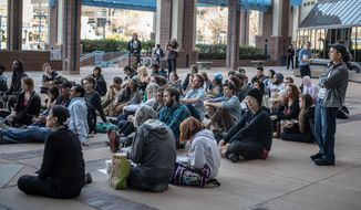 An overflow crowd watches the City Council meeting outside City Hall Monday evening, April 7, 2014, in Albuquerque, NM. (AP Photo/Albuquerque Journal, Roberto Rosales)