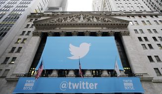 ** FILE ** In this Thursday, Nov. 7, 2013, file photo, a banner with the Twitter logo hangs on the facade of the New York Stock Exchange in New York the day after the company went public. (AP Photo/Mark Lennihan, File)