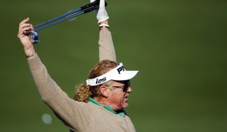 Miguel Angel Jimenez, of Spain, stretches before hitting on the driving range during a practice round for the Masters golf tournament Wednesday, April 9, 2014, in Augusta, Ga. (AP Photo/Matt Slocum)
