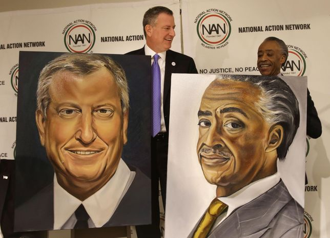 New York City Mayor Bill de Blasio, left, and Rev. Al Sharpton are presented with portraits during the opening ceremonies of the National Action Network convention i