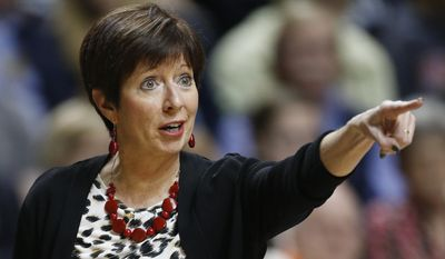 Notre Dame head coach Muffet McGraw speaks to players against Connecticut during the first half of the championship game in the Final Four of the NCAA women's college basketball tournament, Tuesday, April 8, 2014, in Nashville, Tenn. (AP Photo/Mark Humphrey)