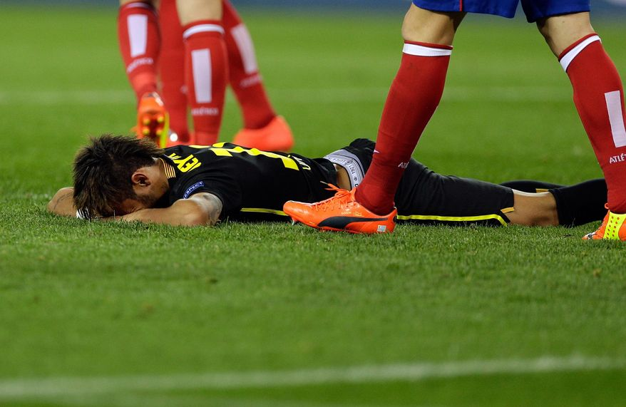 Barcelona's Neymar falls on the pitch during the Champions League quarterfinal second leg soccer match between Atletico Madrid and FC Barcelona in the Vicente Calderon stadium in Madrid, Spain, Wednesday, April 9, 2014. (AP Photo/Paul White)