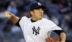 New York Yankees' Masahiro Tanaka pitches during the first inning of a baseball game against the Baltimore Orioles on Wednesday, April 9, 2014, at Yankee Stadium in New York. (AP Photo/Bill Kostroun)