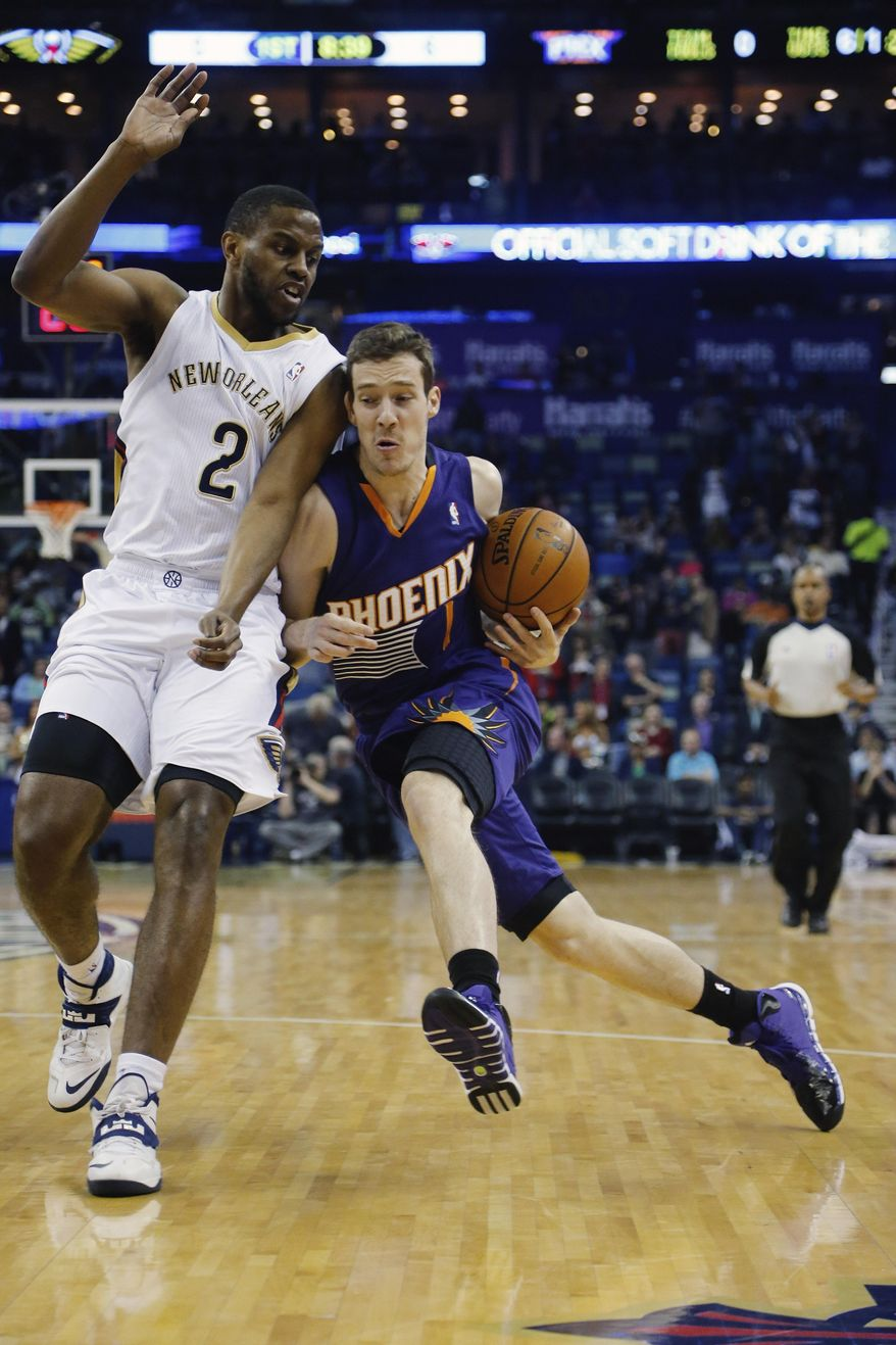 Phoenix Suns guard Goran Dragic (1) gets around New Orleans Pelicans forward Darius Miller (2) in the first half of an NBA basketball game in New Orleans, Wednesday, April 9, 2014. (AP Photo/Bill Haber)
