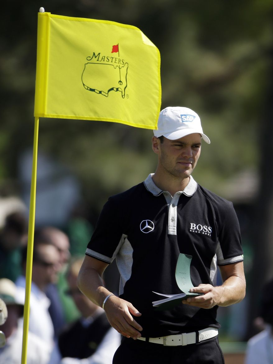 Martin Kaymer, of Germany, takes notes on the seventh green during a practice round for the Masters golf tournament Wednesday, April 9, 2014, in Augusta, Ga. (AP Photo/Darron Cummings)