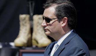 ** FILE ** Sen. Ted Cruz, R-Texas, attends a memorial ceremony for shooting victims, Wednesday, April 9, 2014, at Fort Hood, Texas, where President Barack Obama spoke. (AP Photo/Eric Gay)