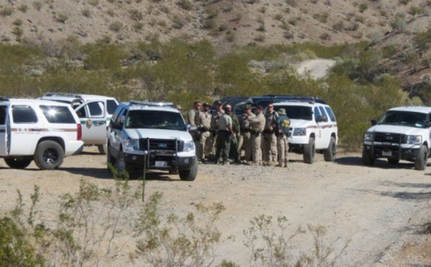 Rancher Clive Bundy snapped this picture of federal officials gathering near his Nevada property. (credit: Washington Free Beacon)