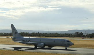 A U.S. Navy P-8 Poseidon taxies along the runway before it takes off from Perth Airport on route to rejoin the on-going search operations for the missing Malaysia Airlines Flight 370 in Perth, Australia, Thursday, April 10, 2014. Planes and ships hunting for the missing Malaysian jetliner zeroed in on a targeted patch of the Indian Ocean on Thursday, after a navy ship picked up underwater signals that are consistent with a plane's black box. (AP Photo/Rob Griffith)