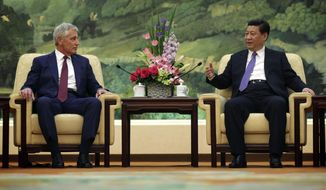 U.S. Defense Secretary Chuck Hagel, left, meets with Chinese President Xi Jinping at the Great Hall of the People Wednesday, April 9, 2014 in Beijing, China. (AP Photo/Alex Wong, Pool)