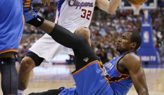 Los Angeles Clippers forward Blake Griffin, top, and Oklahoma City Thunder forward Serge Ibaka, bottom, fall to the court during the first half of an NBA basketball game in Los Angeles, Wednesday, April 9, 2014. Griffin was called for a foul on the play. (AP Photo/Danny Moloshok)