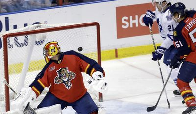 The puck gets past Florida Panthers goalie Roberto Luongo, left, on a goal scored by Toronto Maple Leafs' Tyler Bozak (not shown) in the second period of an NHL hockey game on Thursday, April 10, 2014, in Sunrise, Fla. Maple Leafs' James van Riemsdyk (21) and Florida Panthers' Brian Campbell (51) look on. (AP Photo/Lynne Sladky)