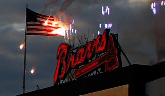 In this frame grab from video provided by JuliePaulk.com, fireworks burn an American flag at Turner Field at a baseball game between the New York Mets and Atlanta Braves, Tuesday, April 8, 2014, in Atlanta. Braves spokeswoman Beth Marshall told local media outlets the team was trying out a new location for a pyrotechnic show on Tuesday when sparks burned holes through the flag that was flying near the display. (AP Photo/JuliePaulk.com)