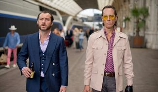 """Jude Law, left, plays a British safecracker with a manic streak released from prison after 12 years in """"Dom Hemingway."""" The film also stars Richard E. Grant. (Fox Searchlight Pictures/Associated Press)"""