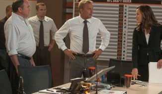 "Kevin Costner, center, portrays the general manager of the Cleveland Browns and Jennifer Garner, right, is the team's lawyer in a scene in ""Draft Day."" (credit)"