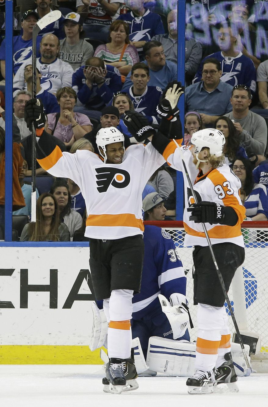 Philadelphia Flyers right wing Wayne Simmonds (17) celebrates with right wing Jakub Voracek (93), of the Czech Republic, after scoring against the Tampa Bay Lightning during the second period of an NHL hockey game Thursday, April 10, 2014, in Tampa, Fla. (AP Photo/Chris O'Meara)