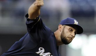 Milwaukee Brewers starting pitcher Marco Estrada delivers a pitch in the first inning of a baseball game against the Philadelphia Phillies on Thursday, April 10, 2014, in Philadelphia. (AP Photo/Michael Perez)