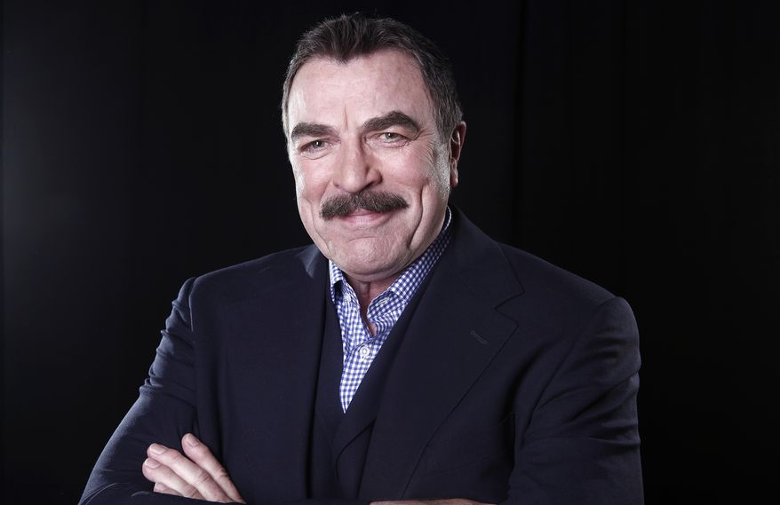 """In this March 21, 2012 photo, actor Tom Selleck poses for a portrait  in New York. On the CBS hit drama, """"Blue Bloods,"""" Selleck plays Frank Reagan, the NYPD Commissioner as well as the patriarch of a family devoted to law enforcement and one another. Selleck is also starring in """"Jesse Stone: Benefit of the Doubt,"""" airing on CBS on May 20. It's the eighth in the series of Jesse Stone TV whodunits that began in 2005, based on characters created by the late Robert B. Parker in his best-selling series of books. (AP Photo/Carlo Allegri)"""