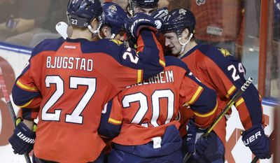 Florida Panthers' Brad Boyes (24) celebrates with Nick Bjugstad (27) and Sean Bergenheim (20) after scoring a goal in the second period of an NHL hockey game against the Toronto Maple Leafs, Thursday, April 10, 2014, in Sunrise, Fla. (AP Photo/Lynne Sladky)