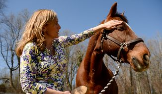 Cindy Johnson loaned her horse Davos to Maryland Therapeutic Riding as an equine therapist.