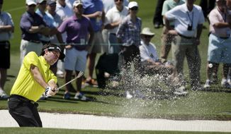 Bubba Watson hits out of a bunker on the second hole during the first round of the Masters golf tournament Thursday, April 10, 2014, in Augusta, Ga. (AP Photo/Chris Carlson)
