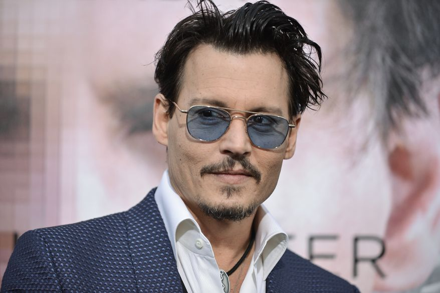 """** FILE ** Johnny Depp arrives at the LA Premiere  Of """"Transcendence"""" on Thursday, April 10, 2014, in Los Angeles. (Photo by Richard Shotwell/Invision/AP)"""