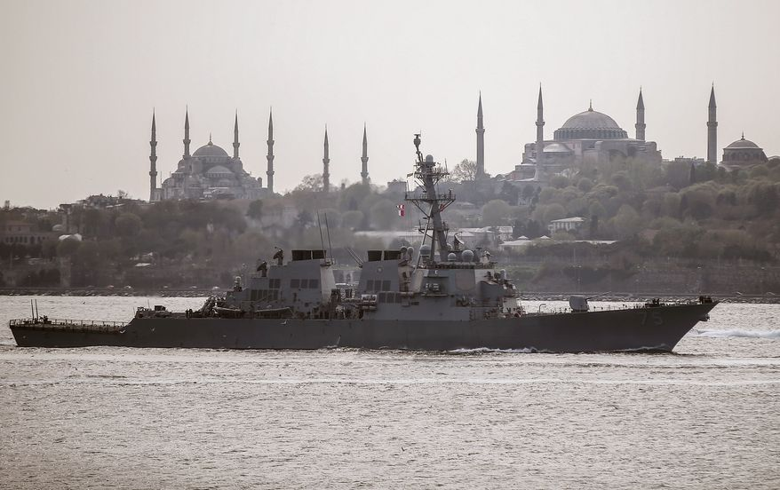 """US warship, the USS Donald Cook, sails through the Bosporus in Istanbul, Turkey, Thursday, April 10, 2014, en route to the Black Sea. According to a US Department of Defense press release, the guided missile destroyer's deployment is part of """" the U.S. commitment to mutual goals in the region,"""" and that it will participate in operations and exercises in the area. Istanbul's  two landmarks Haghia Sophia, right, and Blue Mosque are in the background.(AP Photo/Emrah Gurel)"""