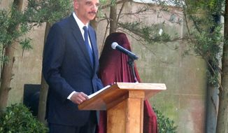 U.S. Attorney General Eric Holder speaks during the dedication of a statue of U.S. District Judge Waties Waring outside the federal courthouse in Charleston, S.C., on Friday, April 11, 2014. Holder said, Waring, the first federal judge to write an opinion challenging separate but equal decades after the policy was declared the law by the U.S. Supreme Court, was morally right and historically gutsy. (AP Photo/Bruce Smith)