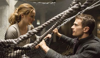 "This image released by Summit Entertainment shows Shailene Woodley, left, and Theo James in a scene from ""Divergent."" Lions Gate Entertainment Corp. says the final book of its ""Divergent"" trilogy will be made into two parts, following the lucrative formula it has used for ""Twilight"" and is repeating for ""The Hunger Games."" (AP Photo/Summit Entertainment, Jaap Buitendijk, file)"
