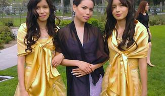 This 2013 photo provided by Miguel Serrato shows twin sisters Marisol Serrato, 17, left, and Marisa Serrato, right, with their sister-in-law Ivette Serrato during a wedding in Riverside, Caif.  The twins were part of the group more than 40 high school students whose trip to visit a college turned tragic when a FedEx tractor-trailer veered across a grassy highway median and slammed into their bus in a wreck that left 10 people dead, authorities said. Marisa was one of the twins on the bus that crashed but is still unaccounted for. Marisol was on another bus that wasn't in the accident. (AP Photo/Courtesy Miguel Serrato)