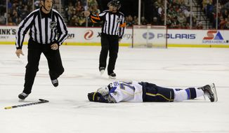St. Louis Blues right wing T.J. Oshie (74) lies on the ice after being injured during the second period of an NHL hockey game against the Minnesota Wild in St. Paul, Minn., Thursday, April 10, 2014. Oshie left the game. The Wild won 4-2. (AP Photo/Ann Heisenfelt)