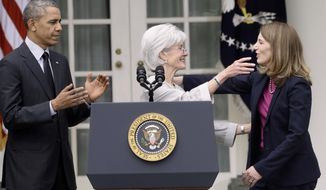 President Barack Obama watches as outgoing Health and Human Services Secretary Kathleen Sebelius, center, goes to hug the president's nominee to replace Sebelius, Budget Director Sylvia Mathews, Friday, April 11, 2014, in the Rose Garden of the White House in Washington, where the president made the announcement.  (AP Photo/Susan Walsh)