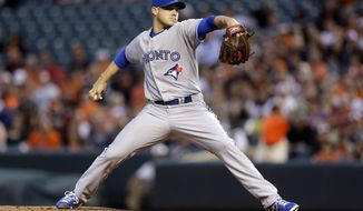 Toronto Blue Jays starting pitcher Dustin McGowan throws to the Baltimore Orioles in the first inning of a baseball game, Friday, April 11, 2014, in Baltimore. (AP Photo/Patrick Semansky)