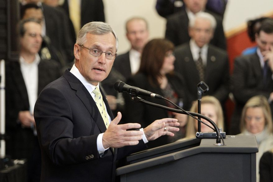 FILE - In this Feb. 2, 2012 file photo, former Ohio State football coach Jim Tressel speaks after being introduced as the new vice president for strategic engagement at the University of Akron, in Akron, Ohio. Tressel has applied to become president at Youngstown State University less than a month after he applied for the same position at the University of Akron. (AP Photo/Mark Duncan, File)