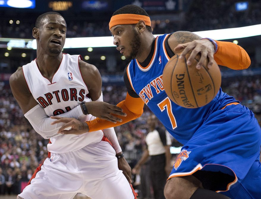 Toronto Raptors guard Terrence Ross (31) defends New York Knicks forward Carmelo Anthony during the first half of an NBA basketball game Friday, April 11, 2014, in Toronto. (AP Photo/The Canadian Press, Frank Gunn)