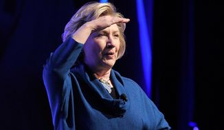Former U.S. Secretary of State Hillary Rodham Clinton looks into the crowd after a person threw an object at her while speaking during The Institute of Scrap Recycling Industries' annual conference at the Mandalay Bay hotel-casino on Thursday, April 10, 2014, in Las Vegas. Clinton, a possible presidential contender in 2016, ducked but did not appear to be hit by the object, and then joked about the incident. Security ushered out a woman who said she threw a shoe but didn't identify herself to reporters or explain the action. (AP Photo/Las Vegas Review-Journal, David Becker)