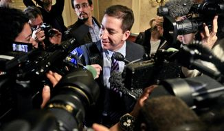 ** FILE ** Glenn Greenwald is surrounded by the media as he arrives for the Polk Awards luncheon on Friday April 11, 2014, in New York. Greenwald of The Guardian came to New York to share a George Polk Award for national security reporting on National Security Agency surveillance. (AP Photo/Bebeto Matthews)