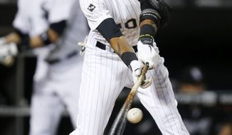 Chicago White Sox's Alexei Ramirez connects for an RBI-single against the Cleveland Indians during the seventh inning of a baseball game on Friday, April 11, 2014, in Chicago. (AP Photo/Andrew A. Nelles)