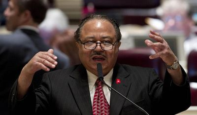 ** FILE ** In this Tuesday, March 20, 2012, file photo, Rep. Alvin Holmes, D-Montgomery, questions a bill that would require candidates for sheriff to have law enforcement training during their session at the Alabama Statehouse in Montgomery, Ala. (AP Photo/Dave Martin, File)
