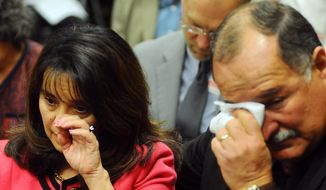 Renetta Torres, left, and her husband Stephen, right, shed tears during the Department of Justice Press Conference on the Albuquerque Police Department practice of use of deadly force, Thursday April 10, 2014. The Torres 's son Christopher was fatally shot in April 2011 by officers servicing a warrant at the family's home. (AP Photo/Albuquerque Journal, Adolphe Pierre-Louis)