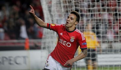 Benfica's Rodrigo, from Spain, celebrates after scoring the opening goal against AZ Alkmaar during the Europa League quarterfinal second leg soccer match between Benfica and AZ Alkmaar at Benfica's Luz stadium in Lisbon, Thursday, April 10, 2014. (AP Photo/Francisco Seco)