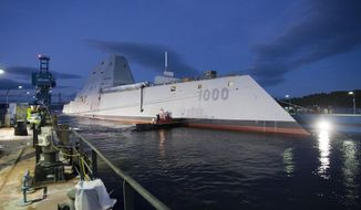 In this image provided by the U.S. Navy the Zumwalt-class guided-missile destroyer DDG 1000 is floated out of dry dock at the General Dynamics Bath Iron Works shipyard Oct. 28, 2013. The ship that bears his name, the first of three Zumwalt-class destroyers, will be christened by Zumwalt's two daughters on Saturday April 12, 2014 at Bath Iron Works. Joining them will be his surviving son, who's a retired Marine, and other relatives.(AP Photo/U.S. Navy)