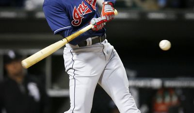 Cleveland Indians' Elliot Johnson hits a double against the Chicago White Sox during the fifth inning of a baseball game on Friday, April 11, 2014, in Chicago. (AP Photo/Andrew A. Nelles)